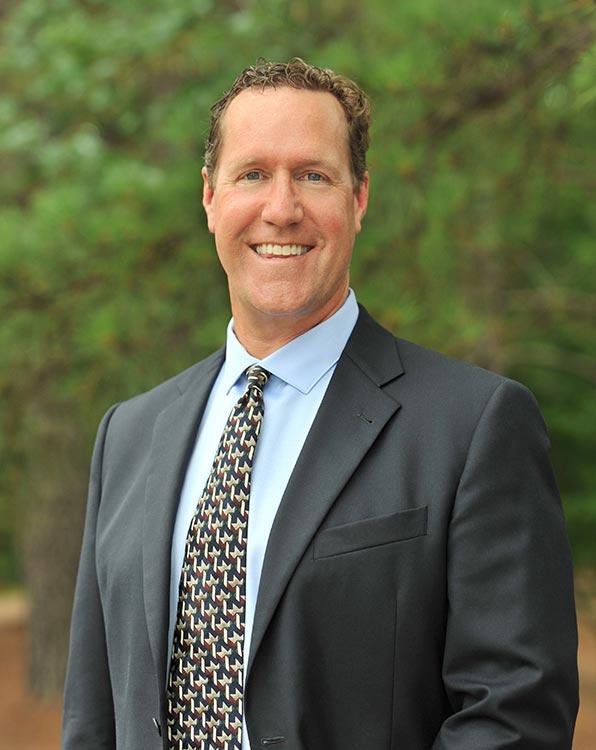 Mark A. Curzan, M.D.